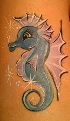 Cute seashorse face painting.