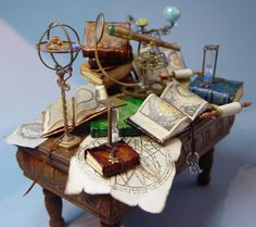 Miniatures with a retro antique, celestial / astronomy theme Source: EV Miniatures  How I imagine Izzie's desk looks like :)