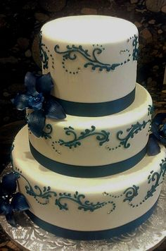 This blue orchid wedding cake was entirely hand piped, and the gum paste flowers were made by Alena.