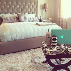 plush bedroom with coffee ottoman!