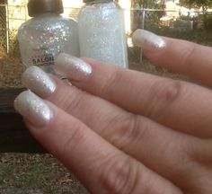 ANGELIC NAILS;  Started out with two coats of OPI pearl white at the salon followed at home by two coats of Sally Hansen's Xtreme Wear #180 Disco Ball, wasn't sparkly enough for me so I got a bottle of Sally Hansen Complete Salon Manicure #140 Snow Globe and applied a layer of that.