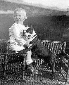 US President Gerald R. Ford, around 3 years old, with his pet Boston Terrier.  Different sources identify the dog as either Spot or Fleck. Circa 1916.