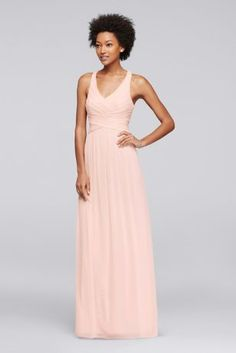 This long mesh bridesmaid dress is a flattering option thanks to the fitted bodice, V-neckline, and crisscross back straps.  Polyester  Back zipper; fully lined  Dry clean  Imported