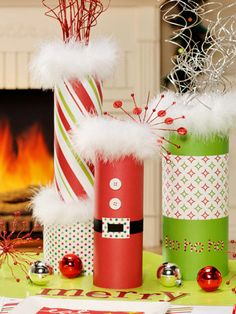 """Everyone will believe in Santa with this festive party theme that puts the focus on colorful vases. The """"Santa"""" vase is the star, backed up with additional vases of varying heights and widths. Wrap each vase in a different, but coordinating, piece of scrapbook paper or wrapping paper. The next slide will give you more Santa details./"""