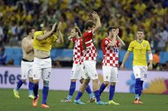 Brazil v Croatia: Group A - 2014 FIFA World Cup Brazil - Croatian players react after they lost the group A World Cup soccer match between Brazil and Croatia, the opening game of the tournament, in the Itaquerao Stadium in Sao Paulo, Brazil, Thursday, June 12, 2014. (AP Photo/Kirsty Wigglesworth)