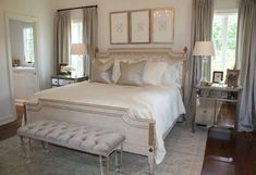 elegant master bedroom, love the sheen of the pillows with the white bright room