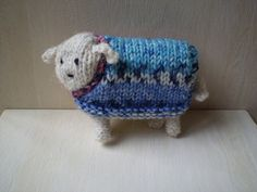 A sheep that fits in the palm of your hand, complete with its own removable jumper. By using 4 ply instead of double knitting the same pattern can be used to make a lamb.