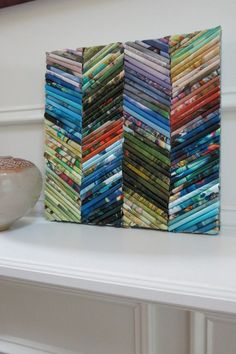 Wall art from rolled magazine pages and gift wrap paper