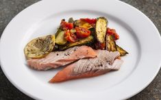 Whole roast trout with roasted tomatoes & courgettes, a quick, light dish perfect for a summer's day.