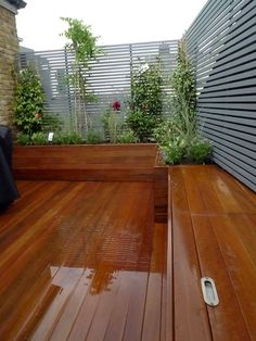 Rooftop garden - London UK. Love the storage bench & planters.