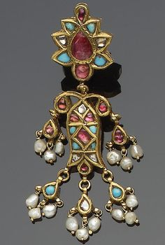 A pair of Indian gem-set gold Earrings each comprising two main elements in the form of a fish and a flower, fringed with seed pearls each 5.5 cm. long(
