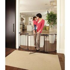 sectional baby gate used to create a safe play are for baby and toddlers baby safety gates for large openings pinterest baby gates baby safety and