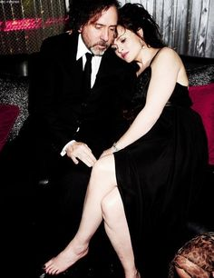 """Tim with Helena. """"We are all a little weird and life's a little weird, and when we find someone whose weirdness is compatible with ours, we join up with them and fall in mutual weirdness and call it love."""""""
