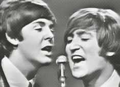 Paul and John singing together on stage