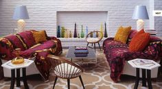 Dapper draping. These white sofas in Palm Springs, California, got a dash of Central Asian purple with vintage vegetable-dyed suzani throws.   Why it works: Any blanket, sheet or remnant of fabric with a dynamic pattern can yield a similar temporary effect.