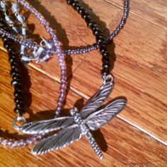 I love dragonflies.  This lavender and black glass seed bead with a silver dragonfly looks great on.  If you would like more information just email me.  Can be made in other colors if you wish.  Only $21.00 plus shipping and it is yours.