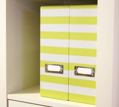 Paint stripes using painter's tape or use stencils to spruce up solid colored office/organizing supplies.
