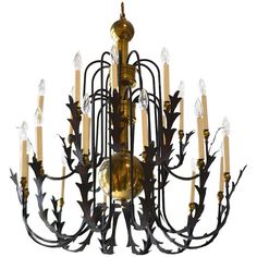 Wrought Iron and Brass Chandelier | From a unique collection of antique and modern chandeliers and pendants  at http://www.1stdibs.com/furniture/lighting/chandeliers-pendant-lights/