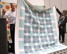 """Transparency"" quilt by Bill Kerr and Weeks Ringle of Modern Quilt Studio. (http://www.modernquiltstudio.com). This quilt uses only 4 solids, yet those 4 really work wonders when put together like this! Here's another great view of it: http://craftnectar.com/2011/01/10/transparency/"