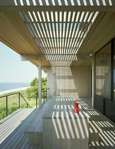 New York architecture firm Tamarkin Co. used 100-year-old cypress salvaged from the swamps and rivers of Georgia and Florida for the skin and structure of this Shelter Island beach house. A former shipbuilder crafted its 36-foot-long beams. photos by: Bart Michiels
