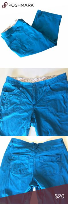 """Lee Blue Bermuda Shorts Women's Bermuda shorts in a fun teal color - perfect for summer! Pair with a yellow shirt, wedge sandals, and a floppy hat for the ultimate summer look. Two front pockets and two back pockets. Great condition. Soft pants with a soft, decorative floral band on the inside.  Size 12, roughly 25 1/2"""" long and 17"""" wide on the hanger.  Brand: Lee, """"Sinfully Soft"""" Made of 98% cotton and 2% spandex. Lee Shorts Bermudas"""