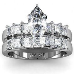 Marquise & Princess Cut Diamond Engagement Ring Wedding Set - A set of stones that compliment each other comes this 14k White Gold Marquise & Princess Cut Diamond Engagement Ring Wedding Set placed in a Prong setting that features a White Marquise center stone with 13 Princess accent stones on the shank & band. The Marquise & Princess ring comes with an SI2 in clarity as well as an H in color. The gem weight is equal to 3.20 carats. All of the diamonds are 100% natural…