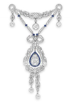 A BELLE EPOQUE DIAMOND & SAPPHIRE BROOCH. Set with a pear-shaped diamond,  approx. 3.14 carats, trimmed with calibré-cut sapphires, swinging within an old European & single-cut diamond wreath, suspending two tassels with collet-set diamond terminals, joined by an old European-cut diamond bow link, from two single-cut diamond & square-cut sapphire chains, to the old European & single-cut diamond foliate bar brooch, suspending three articulated collet-set diamonds, platinum, circa 1915.