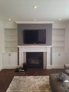 Lovely Basement Renovation On a Budget Fireplace Bookshelves, Fireplace Built Ins, Home Fireplace, Living Room With Fireplace, Fireplace Design, Tiled Fireplace, Fireplaces, Living Room Built Ins, Living Room Plan