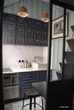 You think you know little? How about an entire apartment that's less than 125 square feet? Yes, it's possible — and it's in Paris.