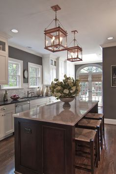 KITCHEN – Eye-catching copper and gray. Traditional copper lanterns set over a marble-topped kitchen island add an unexpected touch to this kitchen. Houzz readers also noted the beautiful trimwork and soothing green-gray wall color when saving this popular kitchen photo to their ideabooks.