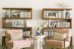 Bookshelf styling inspiration with pink velvet chairs