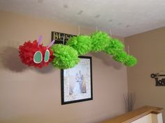 Chelsi's Very Hungry Caterpillar baby shower. Someday I want this guy hanging in my preschool classroom! #veryhungrycaterpillar #tissuepoms