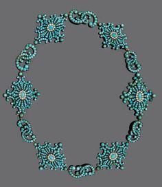 Silver, gold, turquoise and pearl necklace, circa 1850. A very attractive necklece composed of six stylised wreath motifs, each bezel set to the centre with an oval turquoise cabochon framed by seed pearls and turquoise cabochons, linked by two intertwining scrolls set with turquoise cabocons, mountes in silver topped gold.