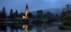 Church lit up at dusk, Lake Bohinj, Slovenia.