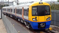 Overground train arriving at a station © Transport for London