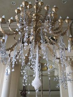 The chandeliers in the house sparkle too. Thischandelier is hung with icey branches, icicles,snowflakes and jewels. Silver Christmas, Christmas 2014, Christmas And New Year, Xmas, Christmas Ideas, Christmas Chandelier, Gold Chandelier, Chandeliers, Fancy Houses