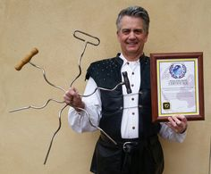 OFFICIAL WORLD RECORD for: Swallowing a Giant Corkscrew World Renowned Sword Swallower Brad Byers