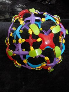 Like a hoberman sphere. Expands as you throw.