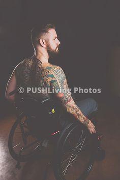 Studio shot of a tatooed man using a wheelchair Serena Creative