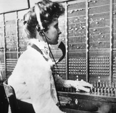 Operator at a switchboard - c1900
