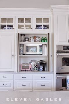 Hidden Appliance Cabinet And Desk Command Center In The Kitchen