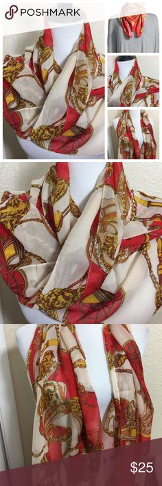 New Gorgeous Silk Red Designer Style 50x23 Scarf New Gorgeous Silk Red & Gold Designer Style 50x23 Scarf. Lovely gold chain and wagon wheel print. This will add a touch of class to any outfit. Pair it with some skinny jeans and a blazer and you're ready for that perfect dinner. Comes in a perfect shade of blue also in my closet. Lovesdesigner Accessories Scarves & Wraps