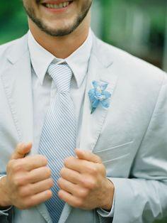 pale blue tux; blue flower