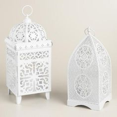 Crafted of pierced metal with a white painted finish in a Moorish tile or floral medallion design, this unique lantern features a bottom opening for easy candle placement.