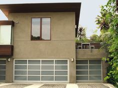 Complement the sleek lines of your contemporary home with Wayne Dalton's Modern Glass Garage Door Model