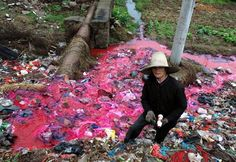 Woman Collects Plastic Bottles Near River Polluted By Reddish Dye http://www.boredpanda.com/pollution-china/