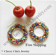 Whimsical multi colored seed bead hoop earrings made with glass seed beads in a rainbow of colors. Dress up your look or wear them as a casual look. The earrings are lightweight and measure 1 3/4 inches across. The hoops hang down to a measurement of 2 1/4 inches. A lot of love and