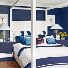 Golfer Greg Norman's Nautical Hobe Sound, Florida, Bedroom   Navy grasscloth wallpaper, slipcovered side tables, and striped bedding (plus fun dip-dyed accent pillows), make the room feel almost like an underwater getaway.