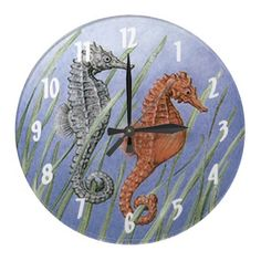 Sea Horses Wallclocks ~ Charming sea horses float along throughout the day on this ocean blue clock with white numbers that can be removed if you would like.