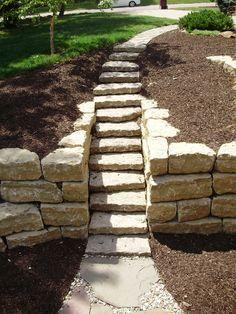 "6"" limestone steps with 14"" ledgerock retaining walls. #TopekaLandscape"